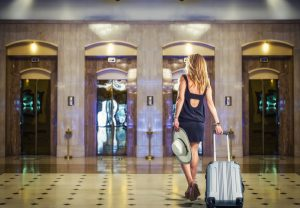 Traveler with Bag in Classy Hotel