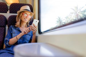 Traveler in Train Relaxing Using Phone