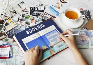 Woman Booking Using Booking Book